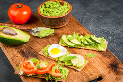 Diet sandwiches with guacamole and fresh vegetables. Healthy Eating, Diet sandwiches on gluten-free loaves - with guacamole, fresh vegetables tomato, cucumber Royalty Free Stock Photo