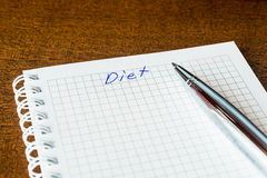 Diet sign in the notebook by pen Stock Images