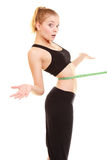 Diet. slim blonde girl with measure tape measuring waist Royalty Free Stock Image