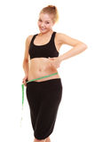 Diet. slim blonde girl with measure tape measuring waist Stock Photos