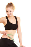 Diet. slim blonde girl with measure tape measuring waist Royalty Free Stock Photos
