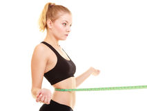 Diet. slim blonde girl with measure tape measuring waist Stock Image