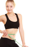 Diet. slim blonde girl with measure tape measuring waist Stock Photography