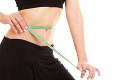 Diet. slim fit girl with measure tape measuring waist Royalty Free Stock Photo