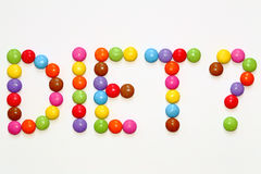 DIET? Smarties Chocolates. Colorful Chocolate Smarties precisely laid out to spell Diet Stock Images
