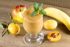 Diet smoothies from loquats, bananas and apples. Stock Photo
