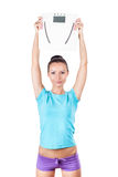 Diet and sport concept -  woman with scale Stock Photography