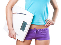 Diet and sport concept -  woman with scale Royalty Free Stock Photos