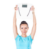 Diet and sport concept -  woman with scale Stock Images