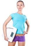Diet and sport concept -  woman with scale Royalty Free Stock Photo