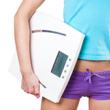 Diet and sport concept -  woman with scale Royalty Free Stock Images