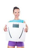Diet and sport concept -  woman shows scale Royalty Free Stock Photography