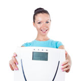 Diet and sport concept -  woman shows scale Royalty Free Stock Photos