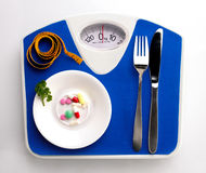 Diet still with scale Stock Images
