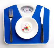 Diet still with scale Royalty Free Stock Images