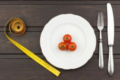 Diet and supplements on a wooden table. Strict diet meals. Slimming diet. Royalty Free Stock Image