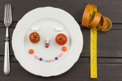 Diet and supplements on a wooden table. Strict diet meals. Slimming diet. Stock Image