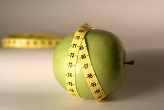 Diet symbol. Green apple as an diet symbol Royalty Free Stock Image