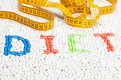 Diet text word made of drugs with centimeter Royalty Free Stock Photography