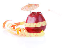 Diet for thin waist as 60 cm. Red apple with tube and umbrella is measure by type with 60 Royalty Free Stock Photo