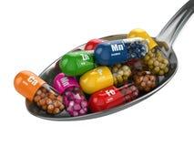 Diet-tillägg. Variationspreventivpillerar. Vitaminkapslar på spooen Arkivfoton