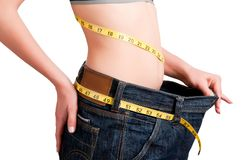Diet Time. Woman seen how much weight she lost. Isolated background Royalty Free Stock Images