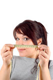 Diet time #3. Attractive woman with measure tape on white background Royalty Free Stock Photo