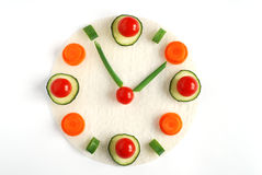Diet time. Healthy vegetables clock on rice paper Royalty Free Stock Photography