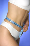 Diet time. Female waist being measured Royalty Free Stock Photography