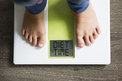 Diet time message on weight scale, overweight child concept royalty free stock photos