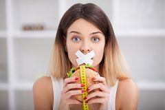 Diet. Unhealthy eating. Junk food concept. Girl don`t eat junk f. Ood stock image
