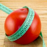 Diet using red tomatoes concept Stock Photography