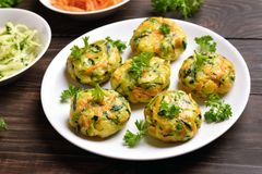 Diet vegetable cutlet from carrot, zucchini, potato. On wooden table. Healthy food. Close up view Stock Photography