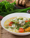 Diet vegetable soup with chicken meatballs and fresh herbs. Royalty Free Stock Photos