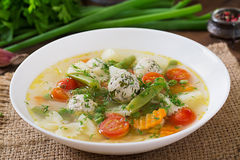 Diet vegetable soup with chicken meatballs and fresh herbs. Stock Images
