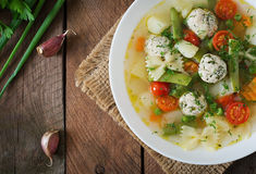 Diet vegetable soup with chicken meatballs and fresh herbs. Top view Royalty Free Stock Images