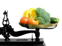 Diet vegetables 2. Vegetables on a tray scale as a suggestion that vegetables are good for diet stock photos