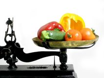 Diet vegetables 3. Vegetables on a tray scale as a suggestion that vegetables are good for diet stock image
