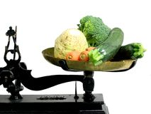Diet vegetables 4. Vegetables on a tray scale as a suggestion that vegetables are good for diet stock images