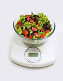 Diet. Vegetables salad in a bowl with weight scale Royalty Free Stock Photography