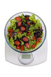 Diet. Vegetables salad in a bowl with weight scale, isolated on Stock Photos