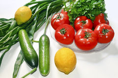 Diet vegetables tomatoes cucumber parsley onion lemons Stock Images