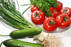 Diet vegetables tomatoes cucumber parsley onion Stock Photo
