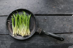 Diet or vegetarian food concept. Ramson or wild garlic. Ramson or wild garlic wild garlic on wood table Stock Photography
