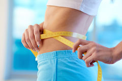 After diet. Waist of slender woman in sportswear Royalty Free Stock Photography