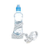 Diet weight loss composition bottle of drinking water. And tape measure on a white background royalty free stock photography