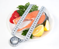 Diet weight loss concept fresh salmon steak lemon Stock Photography