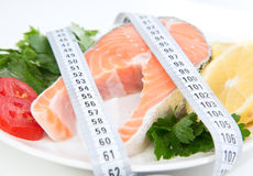 Diet weight loss concept. Fresh salmon steak Stock Images