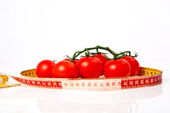 Diet weight loss concept with tape measure organic tomatoes Royalty Free Stock Images