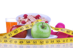 Diet weight loss concept with tape measure red Stock Images